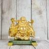 Phật di lạc vàng bóng gánh hai thúng tiền vàng đứng trên đế thuỷ tinh LN191