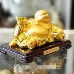 ln190 phat di lac vang 1.jpg 150x150 Phật di lạc vàng bóng tay cầm nén vàng nằm trên túi tài lộc vàng đế gỗ LN190